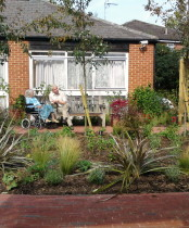 Resident and son enjoying the new Care home garden