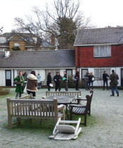 surveying frozen courtyard in Care Home garden