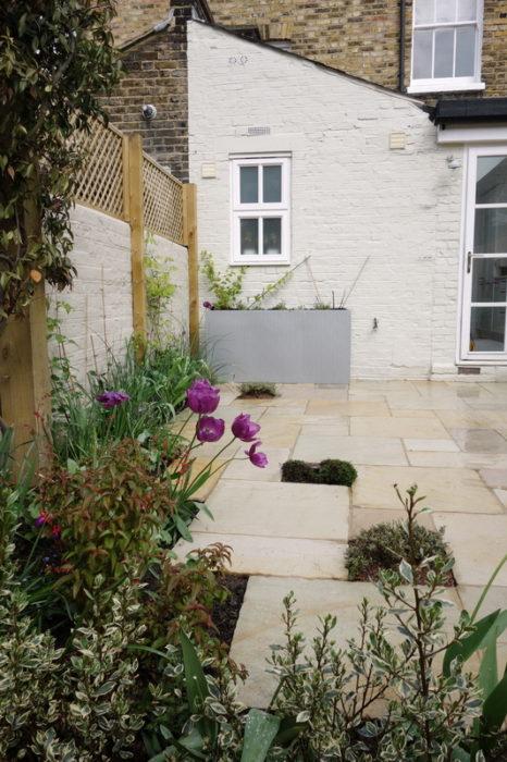 Small garden ideas include Sandstone paving