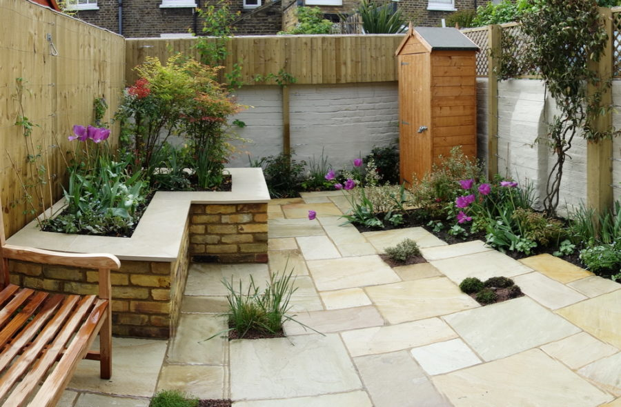 Small Garden ideas with sandstone paving