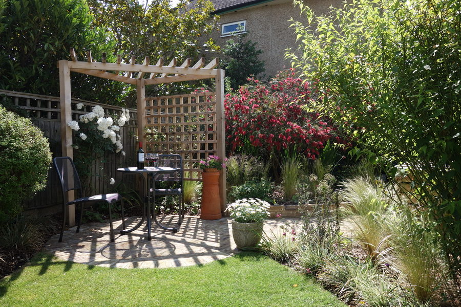 Planting designs with patio and pergola