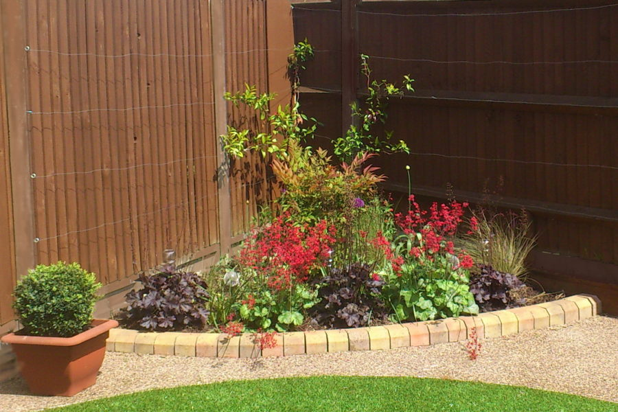 Garden planting design for Northolt. Rhoda Maw Garden Design painted the fence posts and added fabulous colour to this tiny border