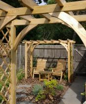 cottage garden planting around pergolas and furniture