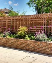 Raised bed in Community Church garden by Rhoda Maw Garden Design