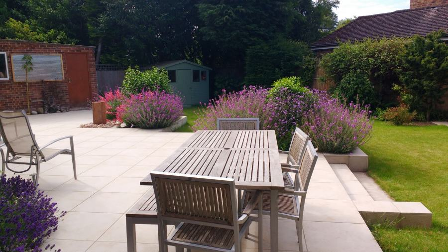 wide shallow garden softened with relaxed planting