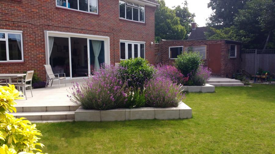 wide shallow garden with bright paving